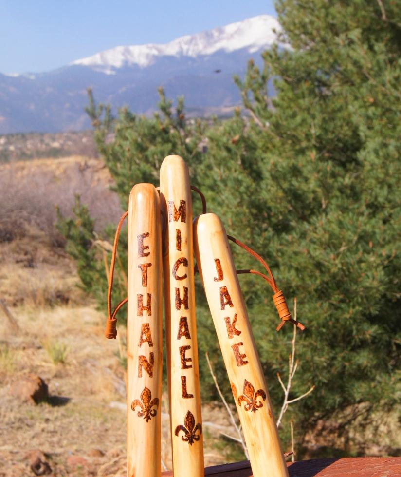 three boyscout sticks
